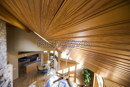 slanted wood ceiling over living room