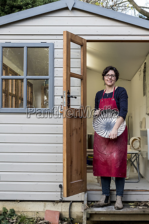 woman wearing red apron standing on