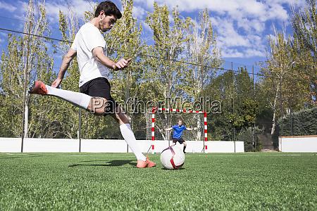 football player shooting the ball on