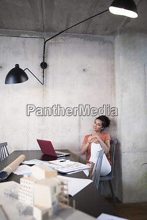 portrait of smiling businesswoman sitting at