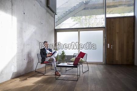 businessman sitting in a loft at