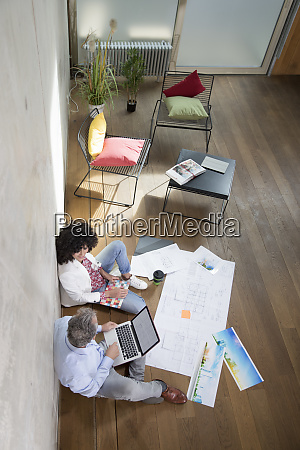 businessman and businesswoman sitting on the