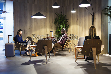 business people sitting in hotel lobby