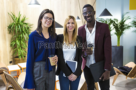 business people standing in hotel lobby