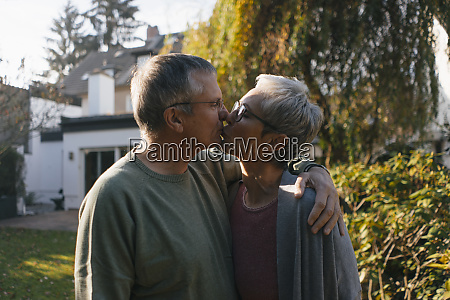 affectionate senior couple embracing and kissing