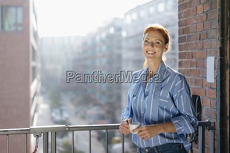 germany hamburg speicherstadt smiling businesswoman with