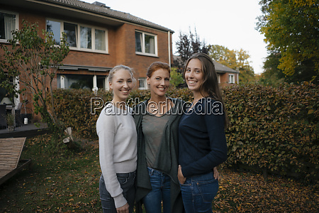 portrait of happy mother with two