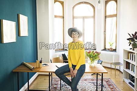 portrait of smiling businesswoman in home