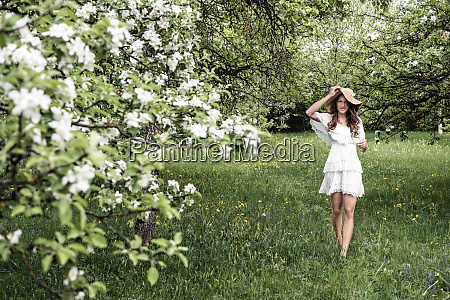 young woman wearing white dress and