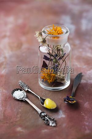 blossoms of medical plants medicine flask