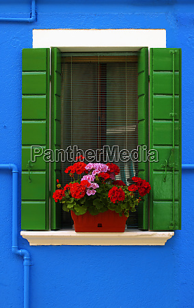 vibrant blue building with window and
