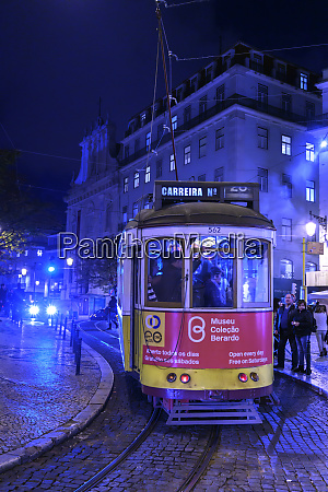 street car and pedestrians at dusk