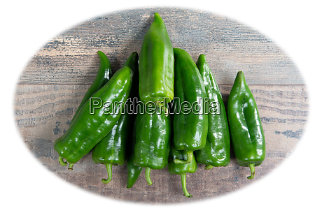 green peppers on the wooden table