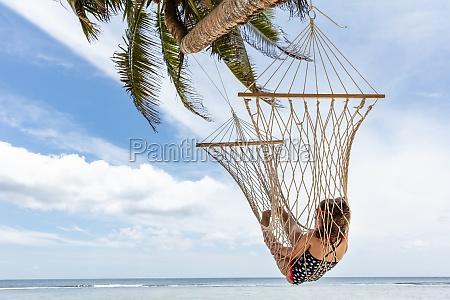 girl lying on hammock hanging on
