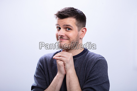 man day dreaming against white background