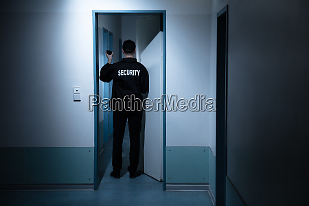 security guard standing in corridor of