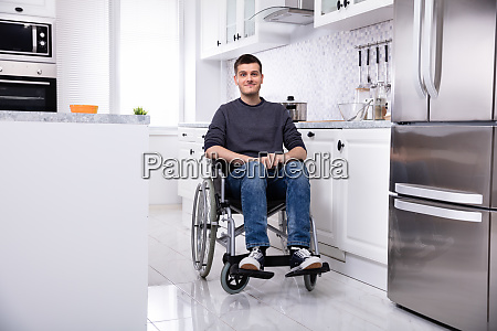 happy handicapped man in kitchen