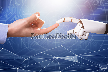robot touching mans index finger