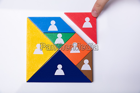 businessman building tangram square block