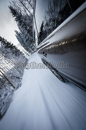 fast moving car on a winter