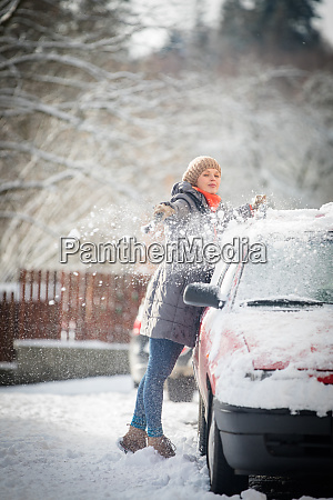 pretty young woman cleaning her car