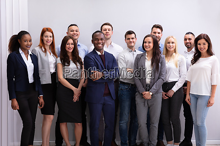 group of smiling businesspeople standing in