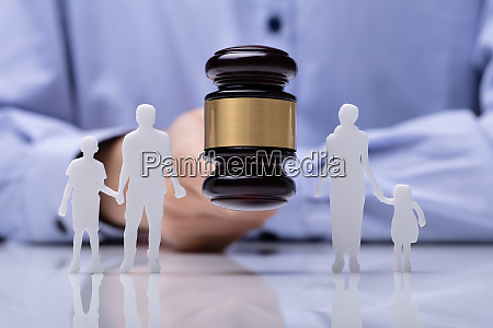 judge striking gavel between family figure
