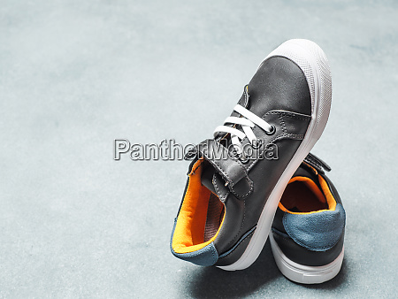 gray and yellow sneakers on gray