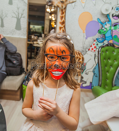 portrait of funny little girl with