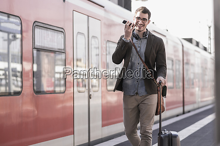 happy young man with cell phone