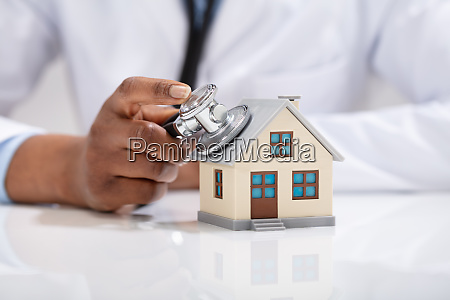 doctor using stethoscope to check model