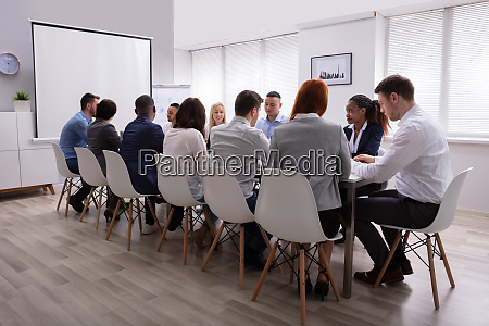 group of business people sitting together