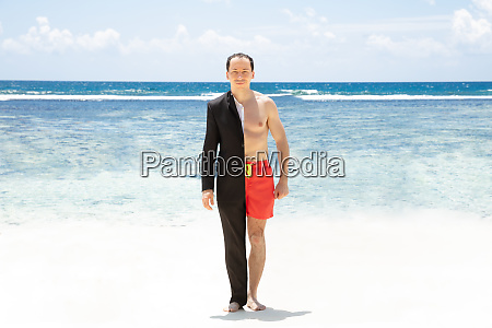 man in formalwear and shorts standing