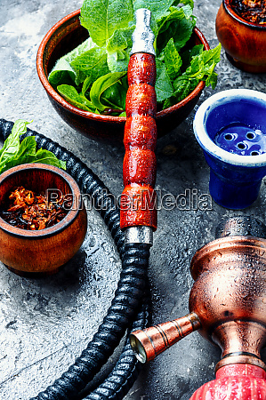 smoking hookah with mint