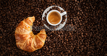 fresh croissant and cup of frothy