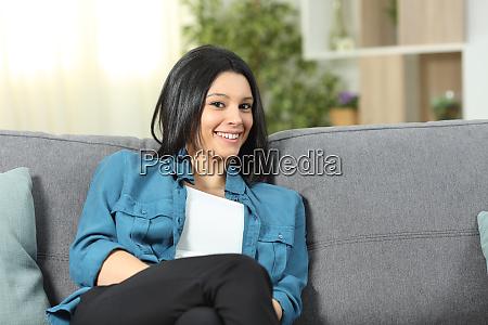 happy woman at home looking at