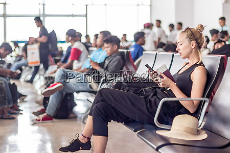 female traveler using her cell phone