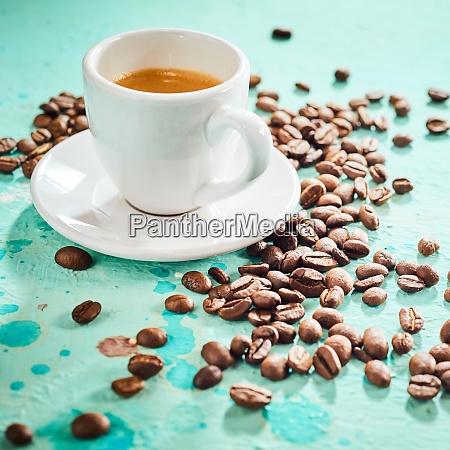 roasted coffee beans and cup of