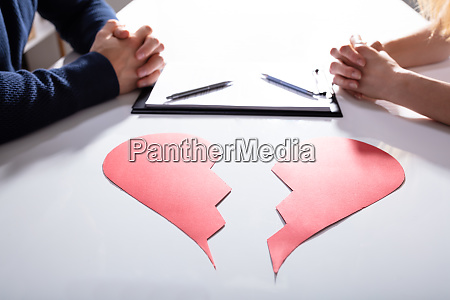 couples hand with divorce paper and