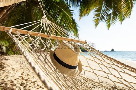 sun hat on hammock at beach