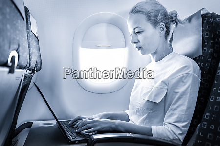 attractive caucasian female passenger working at