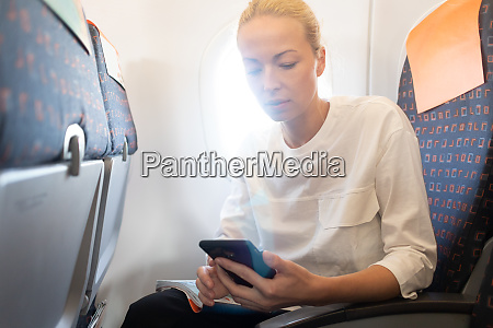 young woman using mobile phone on