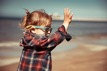 joyful baby on the beach