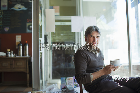 a man sitting in a coffee
