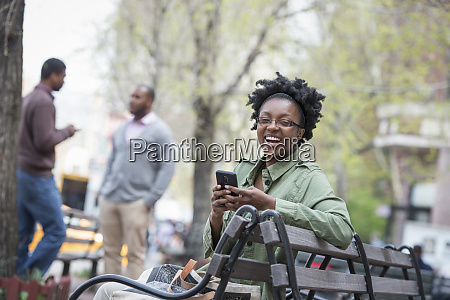 a woman on a bench checking