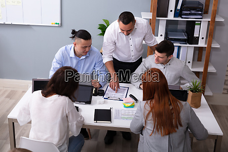 businesspeople discussing together during meeting at