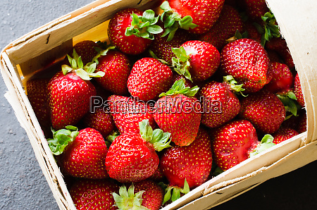 fresh ripe strawberries in a wooden
