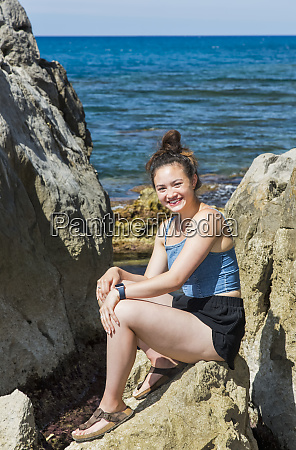 a young female tourist sits on