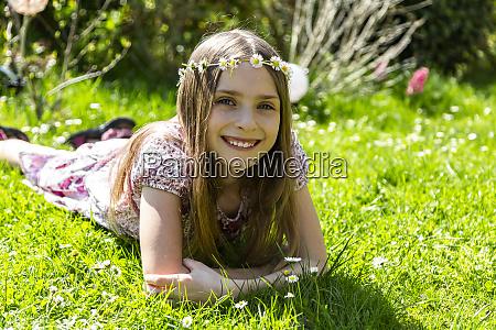 portrait of happy girl lying on