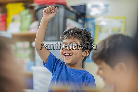happy boy with other children in